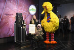 """FILE - In this Friday, Nov. 8, 2019, file photo, Sesame Street's Big Bird and puppeteer Caroll Spinney participate in the ceremonial lighting of the Empire State Building in honor of Sesame Street's 50th anniversary in New York. Spinney, who gave Big Bird his warmth and Oscar the Grouch his growl for nearly 50 years on """"Sesame Street,"""" died Sunday, Dec. 8, 2019, at the age of 85 at his home in Connecticut, according to the Sesame Workshop. (Photo by Evan Agostini/Invision/AP, File)"""