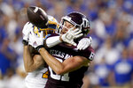 Texas A&M wide receiver Caleb Chapman (81) has the ball knocked away from him by Kent State cornerback Montre Miller, left, for an incomplete pass during the first half of an NCAA college football game on Saturday, Sept. 4, 2021, in College Station, Texas. (AP Photo/Sam Craft)