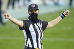 FILE - Down Judge Sarah Thomas gestures during an NFL football game between the Denver Broncos and the Carolina Panthers in Charlotte, N.C., in this Sunday, Dec. 13, 2020, file photo. Sarah Thomas will cap her sixth NFL season by becoming the first female to officiate the Super Bowl in NFL history. Thomas, a down judge, is part of the officiating crew announced Tuesday, Jan. 19, 2021, by the NFL. (AP Photo/Brian Westerholt, File)