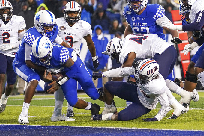 Kentucky quarterback Lynn Bowden Jr. (1) dives into the end zone for a touchdown during the first half of an NCAA college football game against UT Martin, Saturday, Nov. 23, 2019, in Lexington, Ky. (AP Photo/Bryan Woolston)