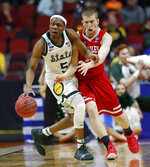 Michigan State guard Cassius Winston (5) is fouled by Bradley guard Nate Kennell, right, during a first round men's college basketball game in the NCAA Tournament, Thursday, March 21, 2019, in Des Moines, Iowa. (AP Photo/Charlie Neibergall)