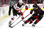 New Jersey Devils' Nikita Gusev (97), of Russia, works against Carolina Hurricanes' Jaccob Slavin (74) during the first period of an NHL hockey game in Raleigh, N.C., Friday, Feb. 14, 2020. (AP Photo/Karl B DeBlaker)