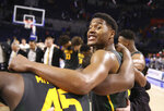 Baylor guard Jared Butler (12) smiles while huddled at midcourt with teammates after an NCAA college basketball game against Florida, Saturday, Jan. 25, 2020, in Gainesville, Fla. (AP Photo/Matt Stamey)