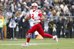 FILE - In this Nov. 2, 2019, file photo, Nebraska quarterback Adrian Martinez (2) looks for a receiver as he scrambles against Purdue during the first half of an NCAA college football game, in West Lafayette, Ind. Nebraska plays at Maryland on Saturday, Nov. 23. Martinez threw for 220 yards and a touchdown last week against Wisconsin and ran for 89 yards and a score.  (AP Photo/Michael Conroy, File)