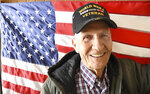 This Nov. 5, 2019 photo shows WWII veteran Harold Stone in Beckley, W.Va.  Stone has lived in Beckley for the majority of his lifetime. However, from 1943 to 1946, he served overseas in WWII in the Army. This makes Stone the only living WWII veteran, that he knows of, in the Beckley area.  (Rick Barbero/The Register-Herald via AP)