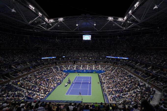 Holger Vitus Nodskov Rune of Denmark, bottom, serves to Novak Djokovic, of Serbia, during the first round of the US Open tennis championships, Tuesday, Aug. 31, 2021, in New York. (AP Photo/Frank Franklin II)