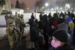 A group of protesters confront several National Guard members outside a museum, late Tuesday, Jan. 5, 2021, in Kenosha, Wis. Earlier it was announced that no charges will be filed against the white police officer that shot Jacob Blake, a Black man in August. (AP Photo/Morry Gash)