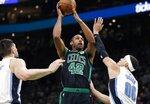 Boston Celtics' Al Horford (42) shoots against Orlando Magic's Aaron Gordon (00) during the first half of an NBA basketball game in Boston, Sunday, April 7, 2019. (AP Photo/Michael Dwyer)