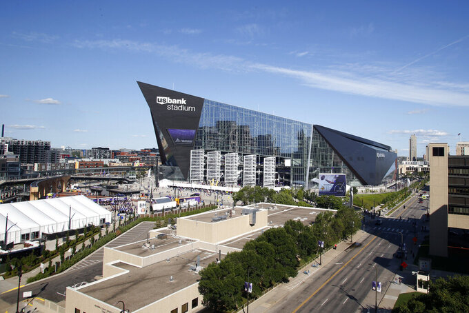 Fans arrive at U.S. Bank Stadium before an NFL preseason football game between the Minnesota Vikings and the Seattle Seahawks, Sunday, Aug. 18, 2019, in Minneapolis. (AP Photo/Bruce Kluckhohn)