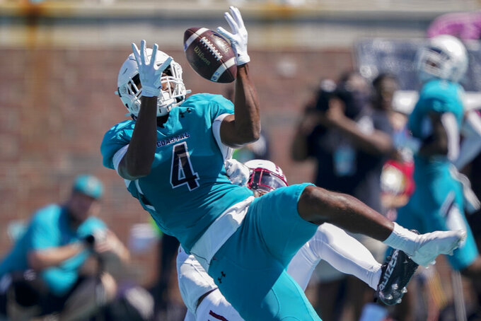 Coastal Carolina tight end Isaiah Likely catches a pass against Massachusetts during the first half of an NCAA college football game on Saturday, Sept. 25, 2021, in Conway, S.C. (AP Photo/Chris Carlson)