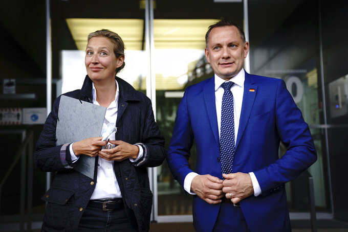 Alice Weidel, left, co-leader of the AfD parliamentary group in the Bundestag, and Tino Chrupalla, co-party leader, introduce themselves as the party's top candidates for the German parliament election in fall at a news conference in Berlin Tuesday, May 25, 2021 . (Kay Nietfeld/dpa via AP)