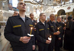Navy sailors attend a religion service to commemorate the crew members that were killed on one of the Russian navy's deep-sea research submersibles at Kronshtadt Navy Cathedral outside St.Petersburg, Russia, Thursday, July 4, 2019. Some crew members survived a fire that killed 14 sailors on one of the Russian navy's deep-sea submersibles, Russia's defense minister said Wednesday without specifying the number of survivors from the blaze. (AP Photo/Dmitri Lovetsky)