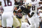 Colorado running back Jarek Broussard runs for a short gain against Texas A&M in the first half of an NCAA college football game, Saturday, Sept. 11, 2021, in Denver. (AP Photo/David Zalubowski)