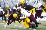 Appalachian State running back Darrynton Evans (3) is tackled by Texas State linebacker Nikolas Daniels (30) during a carry during the first half of an NCAA college football game Saturday, Nov. 23, 2019, in Boone, N.C. (AP Photo/Brian Blanco)