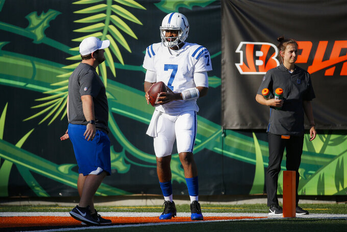 Indianapolis Colts quarterback Jacoby Brissett warms up for the team's NFL preseason football game against the Cincinnati Bengals, Thursday, Aug. 29, 2019, in Cincinnati. (AP Photo/Frank Victores)