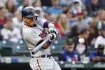 Minnesota Twins' Ehire Adrianza connects for a solo home run against the Seattle Mariners during the third inning of a baseball game Friday, May 17, 2019, in Seattle. (AP Photo/Elaine Thompson)
