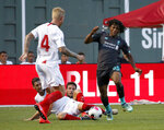 Liverpool's Yasser Larouci, right, powers through a slide from Sevilla's Escudero during the second half of a friendly soccer match at Fenway Park, Sunday, July 21, 2019, in Boston. (AP Photo/Mary Schwalm)