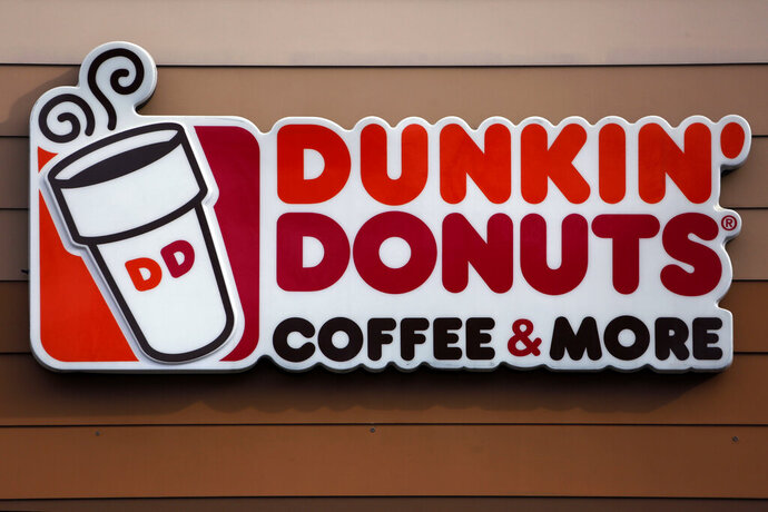 """FILE- This Jan. 22, 2018 file photo shows the Dunkin' Donuts logo on a shop in Mount Lebanon, Pa. The Dunkin' coffee chain says customers will have to do without a """"double cup"""" for their iced drinks.A new campaign focused in Massachusetts and Rhode Island tells customers they can no longer nest their iced drinks in a second, foam cup for extra insulation as the company moves to eliminate its polystyrene cups. (AP Photo/Gene J. Puskar, File)"""
