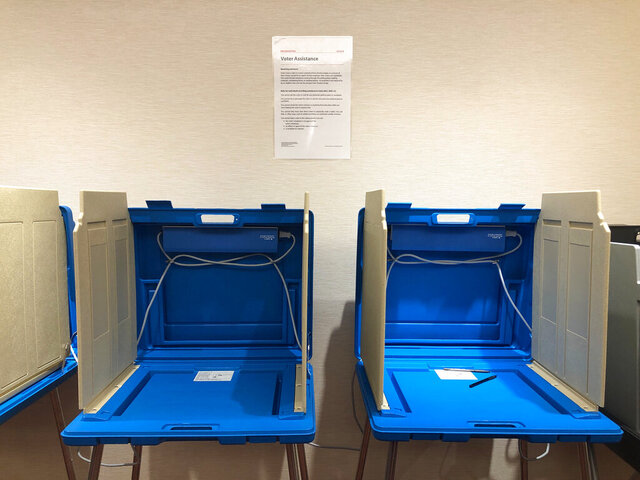 This Jan. 9, 2020 photo shows voting booths already set up at the Hennepin County Government Center in downtown Minneapolis in preparation for the start of early voting on Friday, Jan. 17, in Minnesota's March 3 presidential primary. (AP Photo/Steve Karnowski)