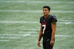 Atlanta Falcons kicker Younghoe Koo (7) warms up before the first half of an NFL football game between the Atlanta Falcons and the Chicago Bears, Sunday, Sept. 27, 2020, in Atlanta. (AP Photo/Brynn Anderson)