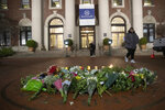 FILE - In this Dec. 12, 2019 file photo, a woman walks past a make-shift memorial for Tessa Majors inside the Barnard College campus in New York.  Authorities say a 14-year-old was arrested in fatal stabbing of Majors on Saturday, Feb. 15, 2020.  Majors was stabbed as she walked through Manhattan's Morningside Park on Dec. 11.   (AP Photo/Mary Altaffer, File)