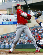 Los Angeles Angels' Shohei Ohtani, of Japan, rears back on a close pitch by Minnesota Twins pitcher Jose Berrios in the third inning of a baseball game Monday, May 13, 2019, in Minneapolis. (AP Photo/Jim Mone)
