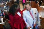 Sen. Katrina Jackson, D-Monroe, talks with Stuart Bishop, R-Lafayette, chairman of the House Ways and Means Committee, during opening day of the Louisiana legislative session in Baton Rouge, La., Monday, April 12, 2021. (AP Photo/Gerald Herbert)