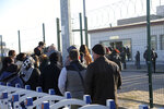 People wait outside a courthouse before the trial of 475 defendants, including generals and fighter jet pilots, in Sincan, Ankara, Turkey, Thursday, Nov. 26, 2020. A Turkish court sentenced several military and civilian personnel at an air base to life prison sentences on Thursday, proclaiming them guilty of involvement in a failed coup attempt in 2016, the state-run news agency reported. (AP Photo)