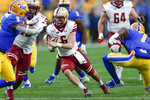 Boston College quarterback Dennis Grosel (6) scrambles for a first down between Pittsburgh defensive back Jazzee Stocker (7) and linebacker Saleem Brightwell (9) during the first half of an NCAA college football game, Saturday, Nov. 30, 2019, in Pittsburgh. (AP Photo/Keith Srakocic)