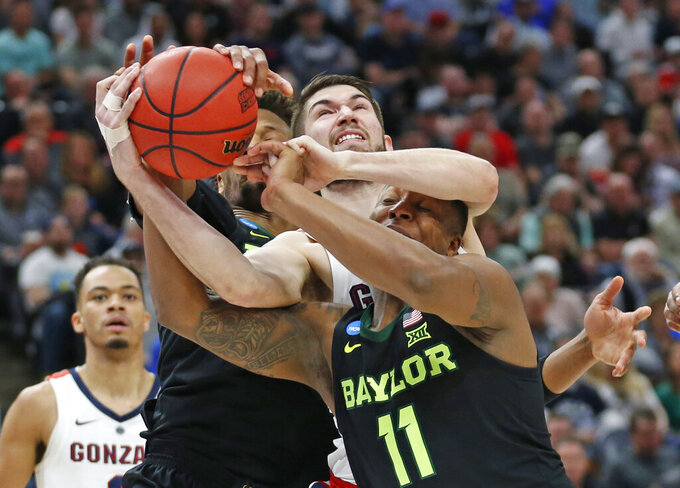 Gonzaga forward Killian Tillie, rear, battles with Baylor guard Mark Vital, bottom, for a rebound during the first half of a second-round game in the NCAA men's college basketball tournament Saturday, March 23, 2019, in Salt Lake City. (AP Photo/Rick Bowmer)