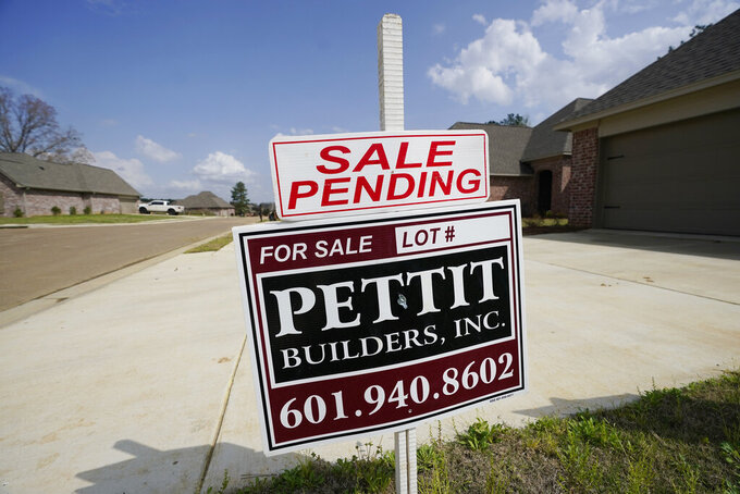 "A ""Sale Pending"" sign stands along side a new driveway in Madison County, Miss., Tuesday, March 16, 2021.  U.S. home prices increased at the fastest pace in seven years in January as the pandemic has fueled demand for single-family houses even as the supply for such homes shrinks. The S&P CoreLogic Case-Shiller 20-city home price index, released Tuesday, March 20, rose 11.1% in January from a year earlier.  (AP Photo/Rogelio V. Solis)"