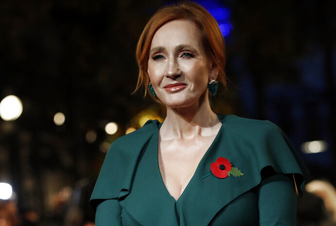 FILE - In this Thursday, Nov. 8, 2018 file photo, writer J.K. Rowling poses for the media at the world premiere of the film