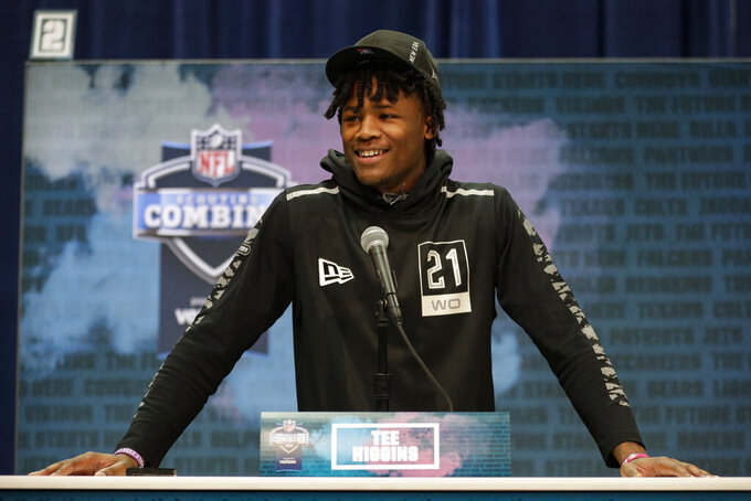 FILE - In this Feb. 25, 2020, file photo, Clemson wide receiver Tee Higgins speaks during a press conference at the NFL football scouting combine in Indianapolis. Higgins is a possible pick in the NFL Draft which runs Thursday, April 23, 2020, thru Saturday, April 25. (AP Photo/Michael Conroy, File)
