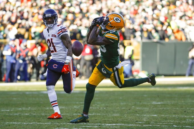 Green Bay Packers' Marquez Valdes-Scantling can't catch a pass in front of Chicago Bears' Ha Ha Clinton-Dix during the first half of an NFL football game Sunday, Dec. 15, 2019, in Green Bay, Wis. (AP Photo/Matt Ludtke)