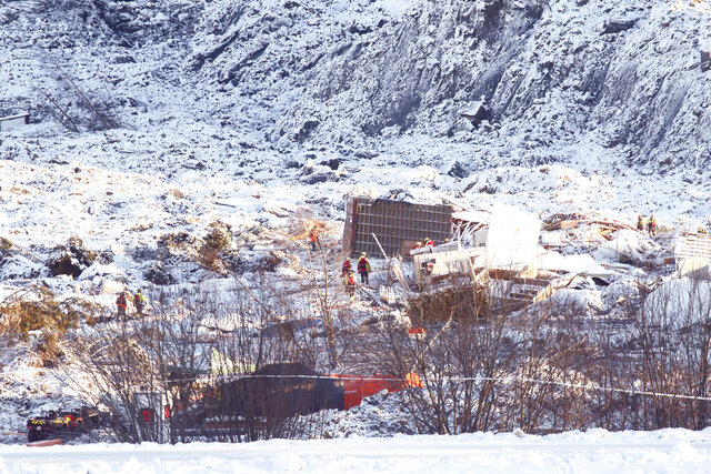 """Rescue workers continue their efforts on the site of a major landslide in Ask, Norway, Monday, Jan. 4, 2021. Norwegian officials are insisting that there's """"still hope"""" of finding survivors in air pockets five days after a landslide killed at least seven people as it carried away homes in a village near the capital. Three people are still missing. (Terje Pedersen/NTB via AP)"""