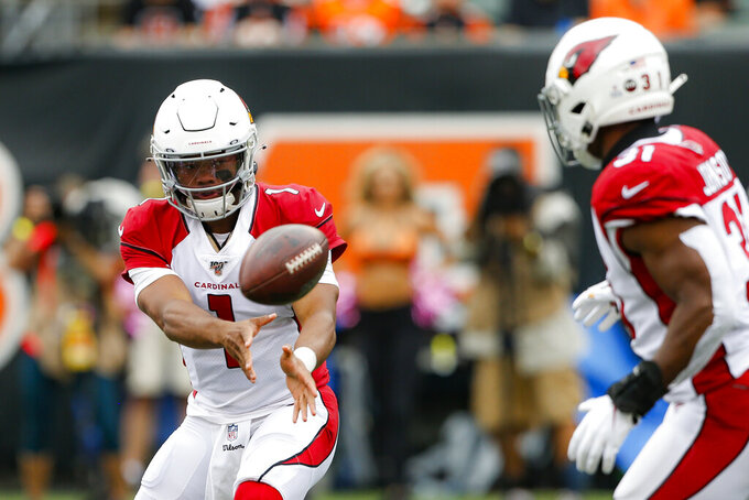Arizona Cardinals quarterback Kyler Murray (1) passes to running back David Johnson (31) in the first half of an NFL football game against the Cincinnati Bengals, Sunday, Oct. 6, 2019, in Cincinnati. (AP Photo/Gary Landers)