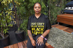 FILE - In this Nov. 4, 2018, file photo, Patrisse Cullors poses for a photo on day three of Summit LA18 in Los Angeles. Black Lives Matter's influence faces a test, as voters in the Tuesday, Nov. 3, 2020, election consider candidates who endorsed or denounced the BLM movement amid a national reckoning on race.