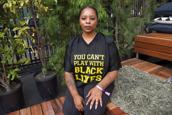 """FILE - In this Nov. 4, 2018, file photo, Patrisse Cullors poses for a photo on day three of Summit LA18 in Los Angeles. Black Lives Matter's influence faces a test, as voters in the Tuesday, Nov. 3, 2020, election consider candidates who endorsed or denounced the BLM movement amid a national reckoning on race. """"We're a very young organization with a whole lot of visibility in a really short amount of time,"""" Cullors, one of three BLM co-founders, told The Associated Press. (Photo by Amy Harris/Invision/AP, File)"""