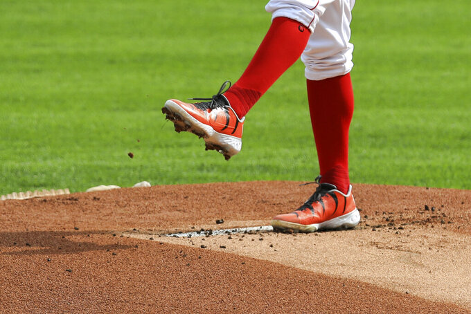 Cincinnati Reds' Trevor Bauer wears custom cleats in support of the Cincinnati Bengals as he throws in the first inning during a baseball game against the Pittsburgh Pirates in Cincinnati, Monday, Sept. 14, 2020. (AP Photo/Aaron Doster)