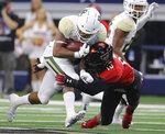 Baylor running back Trestan Ebner (25) runs through Texas Tech defensive back John Bonney (10) in the first half of an NCAA college football game Saturday, Nov. 24, 201 in Arlington, Texas. (Jerry Larson/Waco Tribune-Herald via AP)