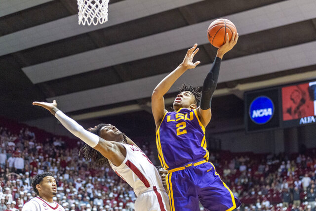 FILE - LSU forward Trendon Watford (2) gets off a shot while colliding with Alabama guard John Petty Jr. (23) during the first half of an NCAA college basketball game in Tuscaloosa, Ala., in this Saturday, Feb. 15, 2020, file photo. Watford averaged 13.6 points and 7.2 rebounds last season and is on the watch list for the Karl Malone award. (AP Photo/Vasha Hunt, File)