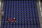 FILE - In this March 12, 2020, file photo, fans sit in a mostly empty Greensboro Coliseum after the NCAA college basketball games were cancelled at the Atlantic Coast Conference tournament in Greensboro, N.C. Scrubbing last year's March Madness due to coronavirus concerns cost the NCAA some $375 million, and another loss like that would have ripple effects throughout college sports. (AP Photo/Gerry Broome, File)