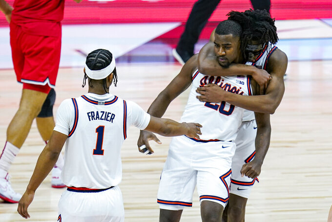 Illinois guard Da'Monte Williams (20) is hugged from behind by guard Ayo Dosunmu (11) and they celebrate with Illinois guard Trent Frazier (1) during the second half of an NCAA college basketball championship game against Ohio State at the Big Ten Conference tournament, Sunday, March 14, 2021, in Indianapolis. (AP Photo/Michael Conroy)