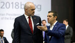 Albanian Prime Minister Edi Rama, left, speaks with Greek Prime Minister Alexis Tsipras during a round table meeting of EU and Western Balkan heads of state at the National Palace of Culture in Sofia, Bulgaria, Thursday, May 17, 2018. (AP Photo Virginia Mayo, Pool)