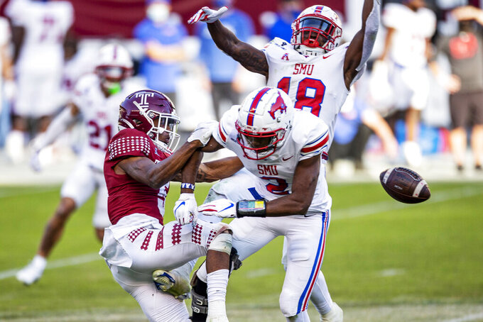 SMU safety Chace Cromartie (18) and defensive back Cam Jones (2) break up a pass intended for Temple wide receiver Jadan Blue (5) during the second half of an NCAA college football game, Saturday, Nov. 7, 2020, in Philadelphia. SMU won 47-23. (AP Photo/Laurence Kesterson)