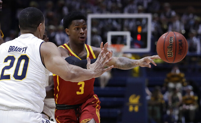Southern California's Elijah Weaver (3) passes the ball away from California's Matt Bradley, left, in the first half of an NCAA college basketball game Saturday, Feb. 16, 2019, in Berkeley, Calif. (AP Photo/Ben Margot)