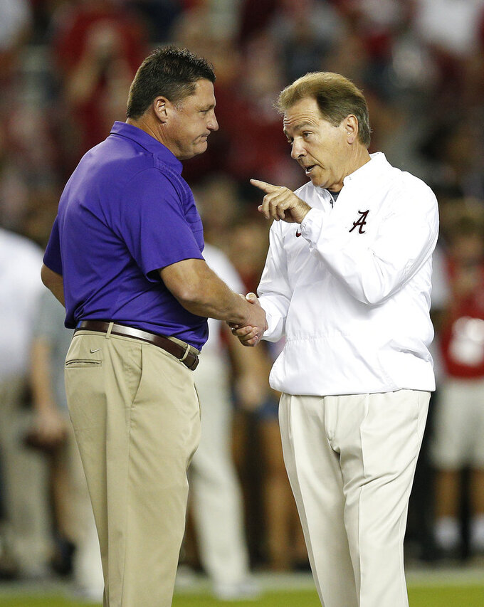 FILE - In this Nov. 4, 2017, file photo, Alabama head coach Nick Saban, right, and LSU head coach Ed Orgeron, left, meet in the center of the field before an NCAA college football game, in Tuscaloosa, Ala. The ability of LSU's Ed Orgeron to exceed expectations this season has the Cajun coach on the brink of considerably augmenting his legacy in his native state _ particularly if he can end a streak of futility against No. 1 Alabama. (AP Photo/Brynn Anderson, File)
