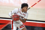 Texas Tech's Terrence Shannon Jr. (1) controls the ball in the first half of an NCAA college basketball game against Kansas in Lubbock, Texas, Thursday, Dec. 17, 2020. (AP Photo/Justin Rex)