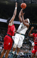 Michigan State's Cassius Winston, right, shoots against Rutgers' Ron Harper Jr. during the first half of an NCAA college basketball game, Sunday, Dec. 8, 2019, in East Lansing, Mich. (AP Photo/Al Goldis)