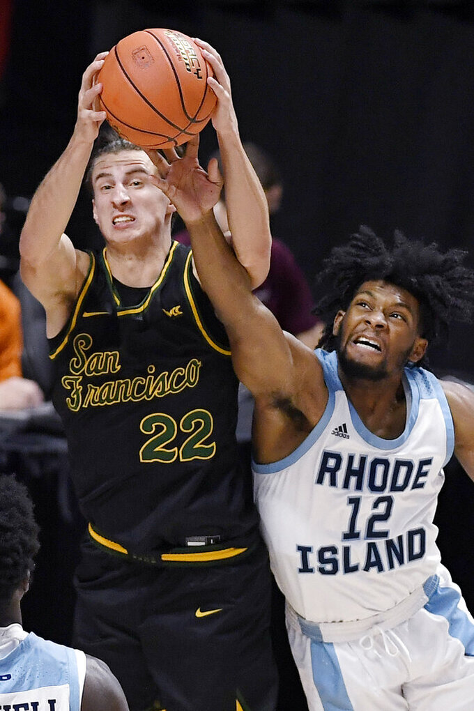 San Francisco's Dzmitry Ryuny, left, pulls down a rebound over Rhode Island's Malik Martin in the second half of an NCAA college basketball game, Sunday, Nov. 29, 2020, in Uncasville, Conn. (AP Photo/Jessica Hill)